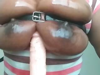 Wollfeey13 Slides Dildo Between Oily Tittys