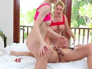 Elegant Teen And Her Milf Mother In The Bed