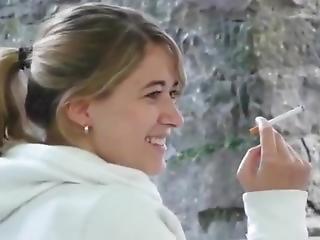 Cute Girl Smokes A Cork