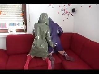 Two Girls In Plastic Pvc Raincoats