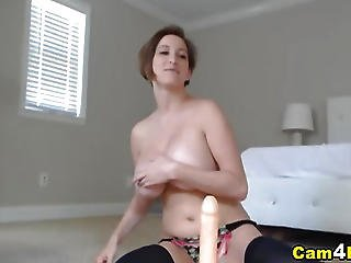 Busty Babe Titty Fucks And Rides With Her Dildo