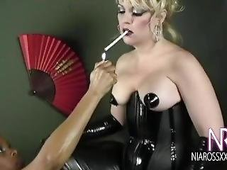 Dominatrix Gets A Smoky Big Dildo Blowjob From Her Submissive Girlfriend