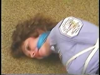 Policewoman Hogtied On Floor