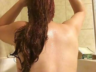 Redhead Washing Her Long Curly Hair With Shampoo In Bath Tub - Sexy Back