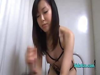 Asian Girl In Sexy Lingerie Jerking Off Guy Cock Cum To Hand On The Bed
