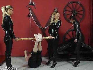 Blonde Mistress With Latex Catsuit & High Heels Boots Whipping Her Slave