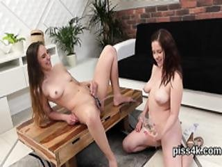 Erotic Lesbian Sweeties Get Sprayed With Pee And Splash Wet Cunts