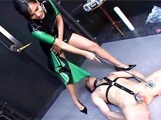 Rubber Mistress Dominate Guy In Bondage