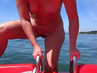 Wife Peeing From A Pedal Boat Into Lake Constance