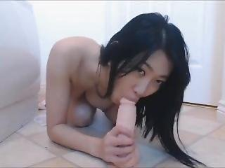 Asian Teen Spinner Gets Dirty With Big Dildo