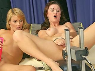 A Brunette Is Penetrated To Orgasm By An Air Pressure Mechanical Dildo While Blond Watches
