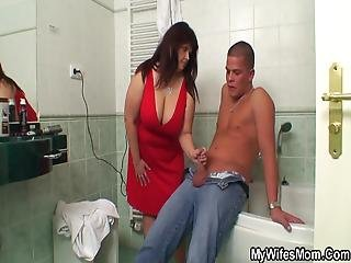 Busty In Law Riding Cock In The Bathroom