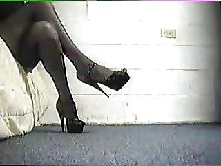 Black 6 Inch Heels Thigh High Stockings And Mini Skirt