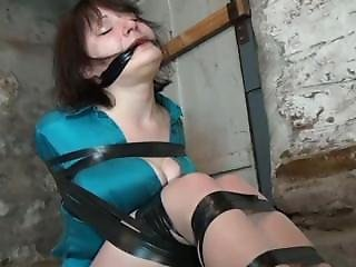 Milf Brutally Taped In The Basement