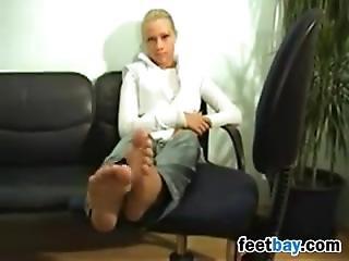 Blonde Teasing Her Beautiful Feet