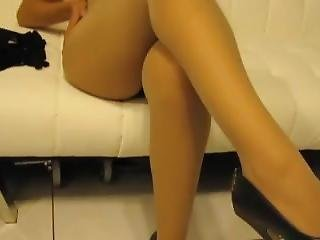 Latina In Tight Black Upskirt And Nude Pantyhose