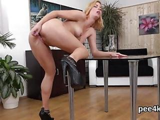 Gorgeous Cutie Is Urinating And Finger Fucking Shaven Twat