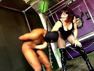 Muscular Woman Ballbusting Black Slave