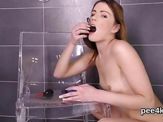 Exquisite Chick Is Pissing And Masturbating Shaved Vagina
