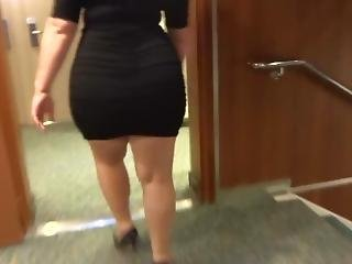 Hot Blonde Milf Walking In A Black Dress