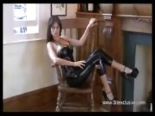 Black latex dress and fetish wear on posing softcore solo model Alyss in pv