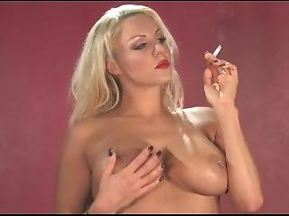 Dannii Harwood Shows Her Boobs While Smoking