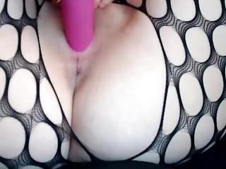 Girl In Mesh Pantyhose Fucks Herself Pink Dildo In The Vagina