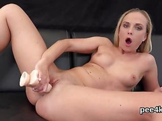 Breathtaking Girl Is Pissing And Masturbating Shaven Slit