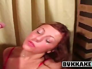 Brunette Slut Gets Drenched In Cum At Bukkake