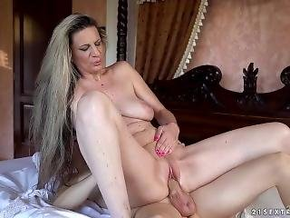 Mature Conchita With Younger Boy