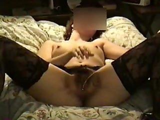 Wife in stockings masturbates hairy pussy