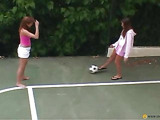 Two Girls Ride A Soccer Ball