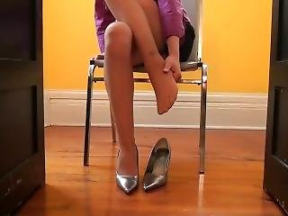Massaging Painful Foot In Pantyhose And High Heels