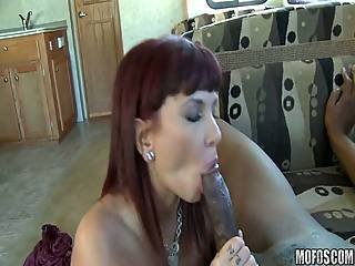 Redheaded Whore Gets A Big Black Cock Deep In Her Ass