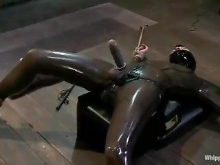 Sexy Blonde Puts On A Latex Costume And A Strap- On