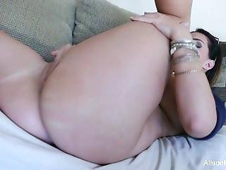 Alison Tyler rubs her wet pussy on the couch