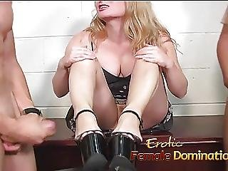 Slutty Blonde Dominatrix Having Fun Playing With A Slaves