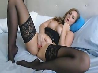 Beautiful Woman In Black Stockings Masturbates Lustfully