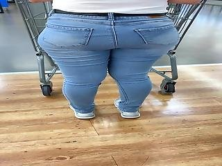 Short Latina In Blue Jeans With Nice Booty Standing In Line