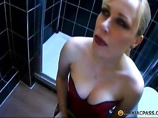 Blond Woman Sitting On The Toilet