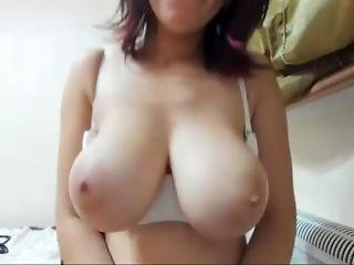 Big Boobed Girl Plays With Her Massive Tits On Webcam