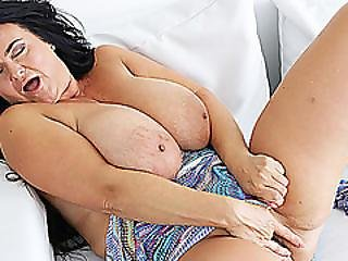 Milf Busty Reny Shows Her Gigantic Boobs At The Camera