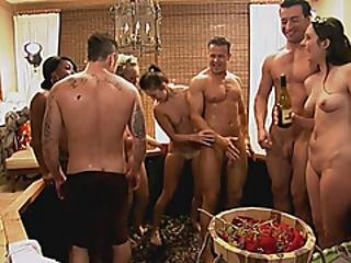 Humans Stepping On Gerotics In Huge Barrel To Make Wine