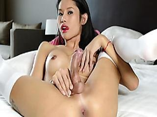 Asian Ladyboy Sai Shoves A Huge Dildo Into Her Butt And Jerks Off