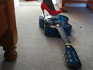 Guitar Crushed And Destroyed In High Heels