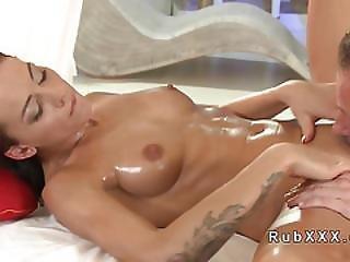 Masseur Eats Oiled Busty Brunette Babe