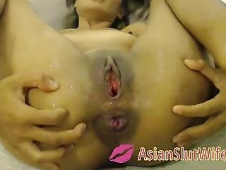 Asian Teen Squirting With Anal Dildo And Anal Gape