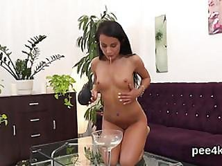 Stunning Cutie Is Peeing And Pleasing Shaved Twat