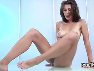 Enchanting Nympho Is Peeing And Pleasuring Shaven Cunt
