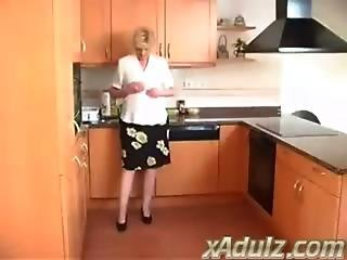 Horny Blonde Granny In The Kitchen Masturbates To Orgasm With Dildo